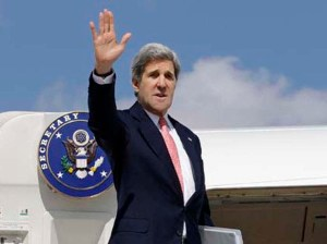 U.S. Secretary of State John Kerry waves as he leaves Ankara