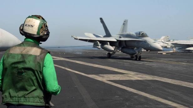 FA18 Super Hornet lands aboard the aircraft carrier USS George HW Bush