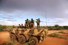 Troops belonging to the African Union stand on top of an APC on the outskirts of Burubow in the Gedo region of Somalia on February 14.  Burdubow, a town in the Gedo region of Somalia, was captured on Feb 9 in a joint operation by African Union and Somali National Army troops. AU UN IST PHOTO / Mahamud Hassan
