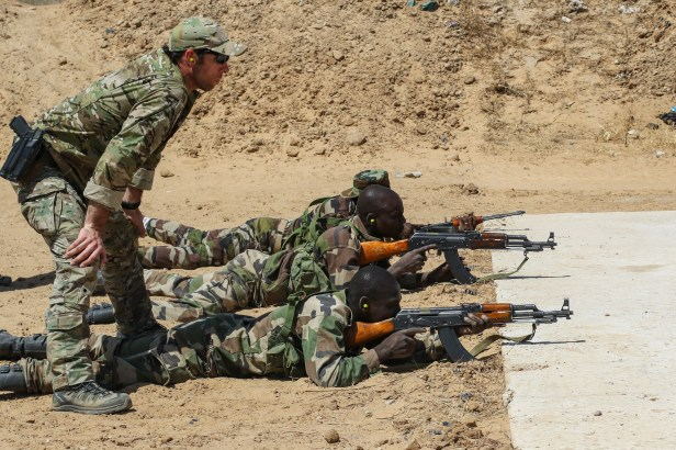 US Army Special Forces Sgt observes Niger Army soldier during marksmanship training Credit AFRICOM